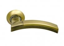 Ручка дверная на круглой розетке фалевая Archie Sillur 132, Золото матовое/Бронза античная