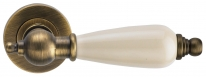 Ручка дверная на круглой розетке Archie Redondo, Кофе античный/Керамика слоновая rость