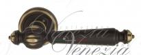 Ручка дверная на круглой розетке Venezia Pellestrina D1 Бронза темная