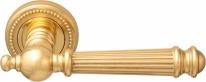 Ручка дверная на круглой розетке Melodia Veronica 102L Латунь