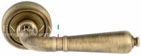 Ручка дверная на круглой розетке Extreza PETRA (Петра) 304  R01 Бронза матовая F03