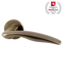 Ручка дверная на круглой розетке Armadillo WAVE URS AB-7 Бронза